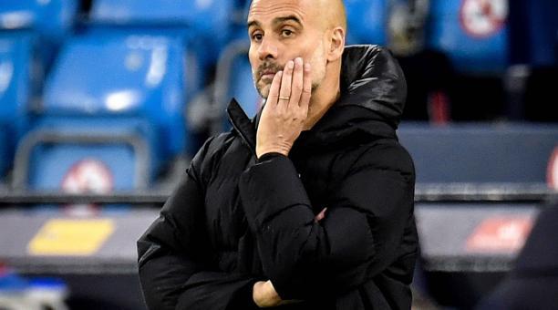 El entrenador del Manchester City, Pep Guardiola, reacciona durante la semifinal de la Liga de Campeones de la UEFA, segundo partido de fútbol entre el Manchester City y el Paris Saint-Germain en Manchester, Reino Unido, 04 de mayo de 2021. (Liga de Campe