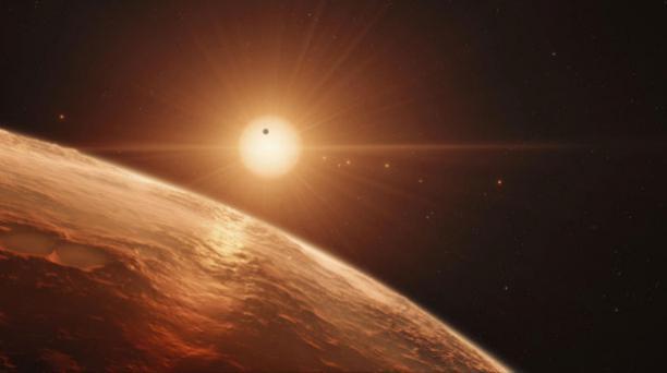 Fotografía facilitada por el Observatorio Europeo Austral (ESO) Que muestra una impresión artística de la vista desde la superficie de uno de los planetas del sistema TRAPPIST-1. Foto: EFE/ ESO.